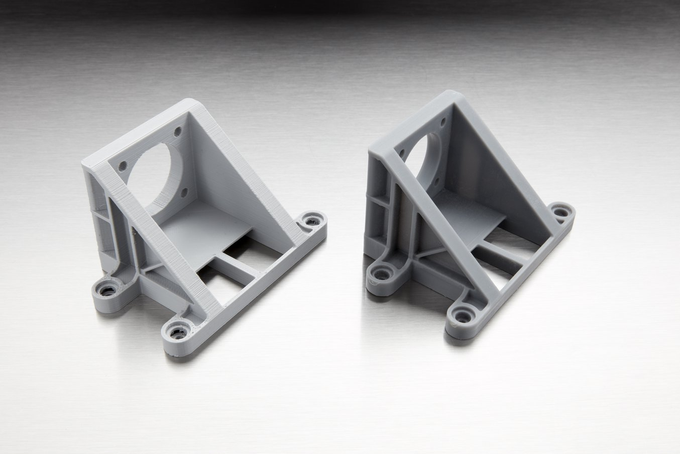 The difference in quality is less visible on relatively simple parts. However, SLA parts are dense and isotropic, which makes them better suited for many engineering and manufacturing applications (FDM part on the left, SLA part on the right).