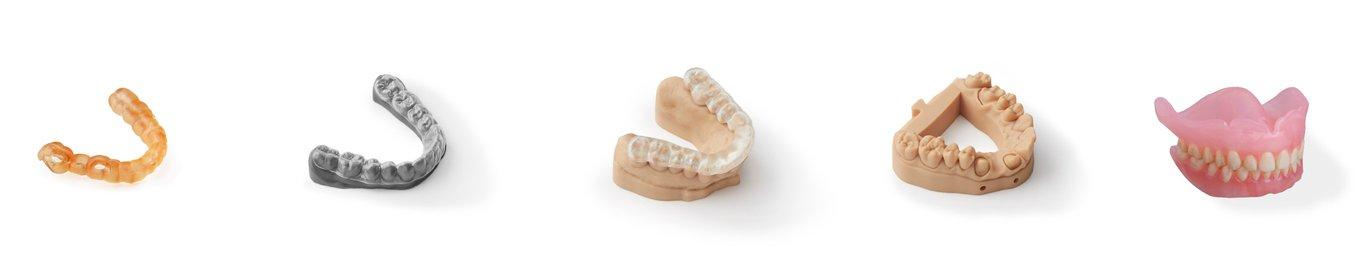Una selezione di prodotti dentali realizzati tramite la tecnologia di stampa 3D stereolitografica.
