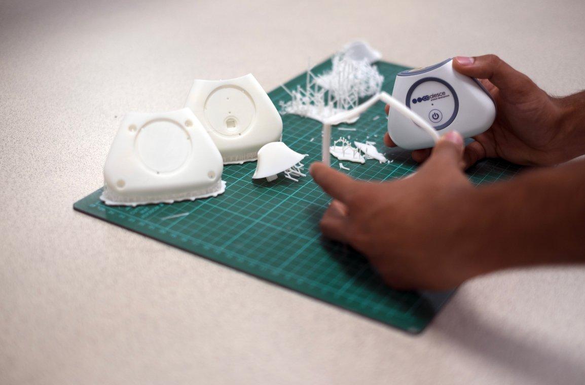 hands holding 3D print