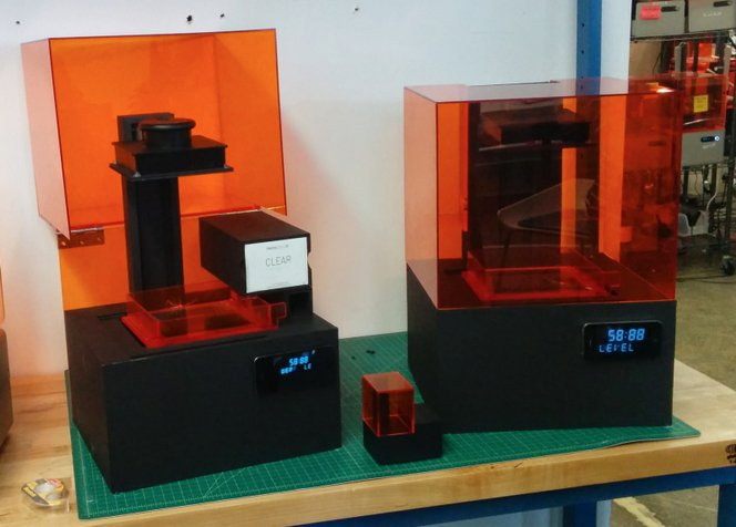 Looks-like prototypes of the Form 2 SLA 3D printer with different solutions for cartridge placement.