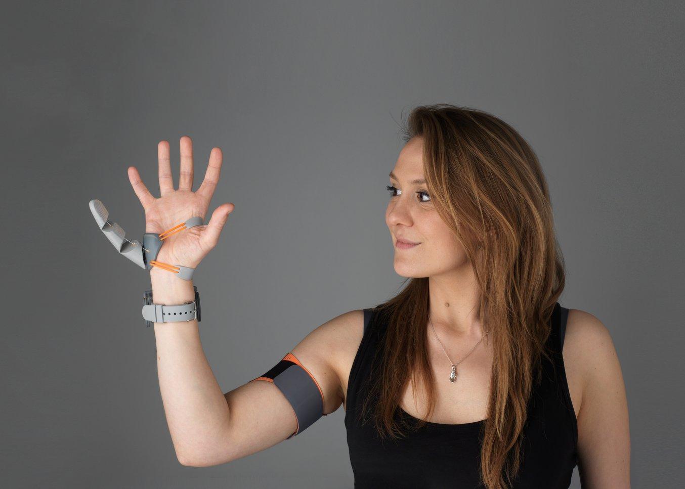 Dani Clode wearing the third thumb.