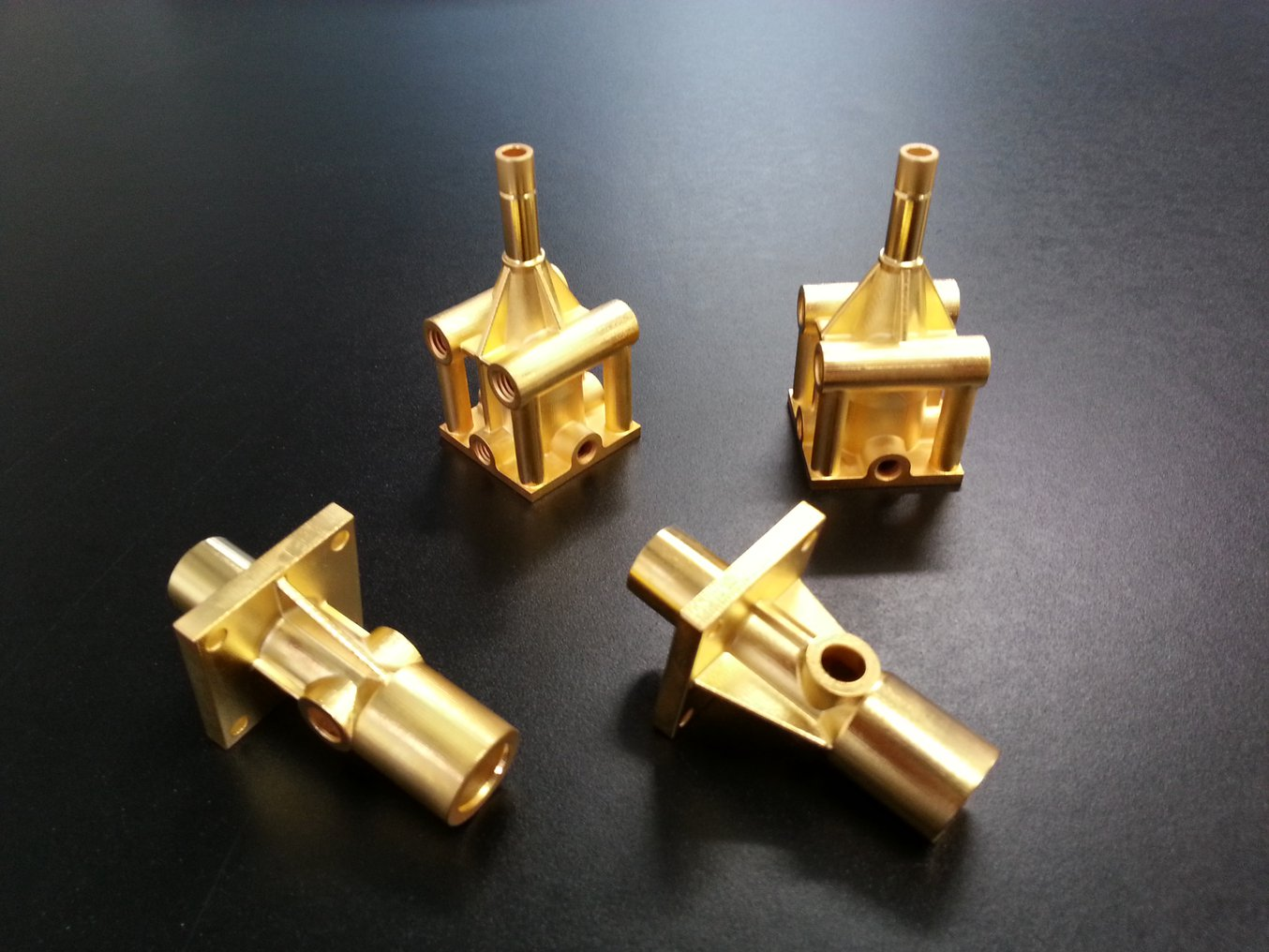 3D printed parts in gold, electroplated by the Swiss company Galvotec, one of few in the world specializing in metal coating for rapid prototyping.