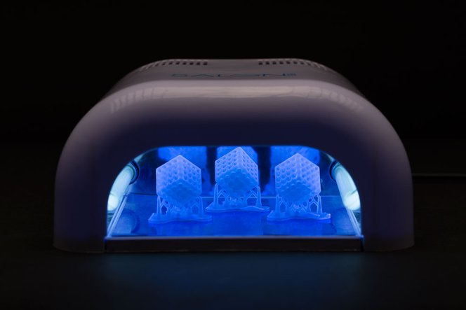 Many methods of post-curing exist, such as this UV nail salon.