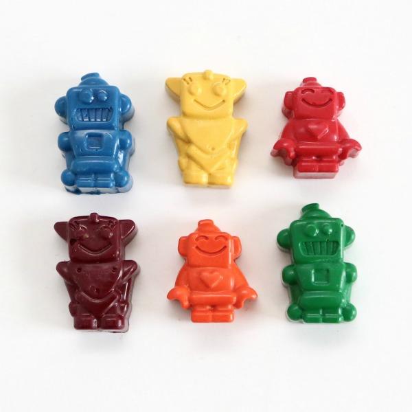 Crayons en forme de robot moulés en silicone par Tinta Crayons.