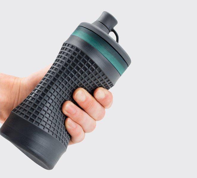 A water bottle prototype 3D printed in Flexible Resin.