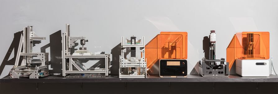 Consecutive prototypes of the Form 1, the first desktop stereolithography (SLA) 3D printer.