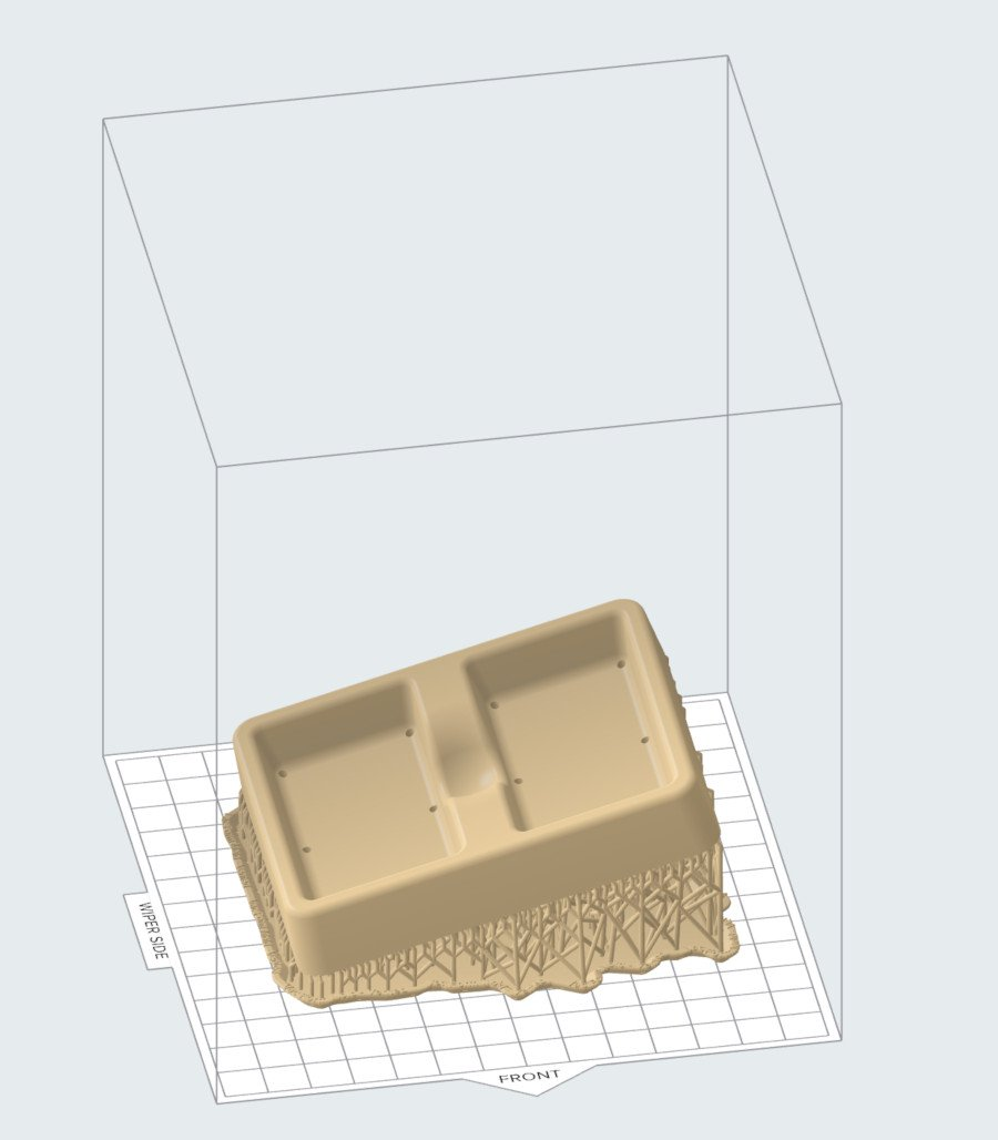 Un ejemplo: una pieza con soportes de impresión en la parte inferior del objeto.