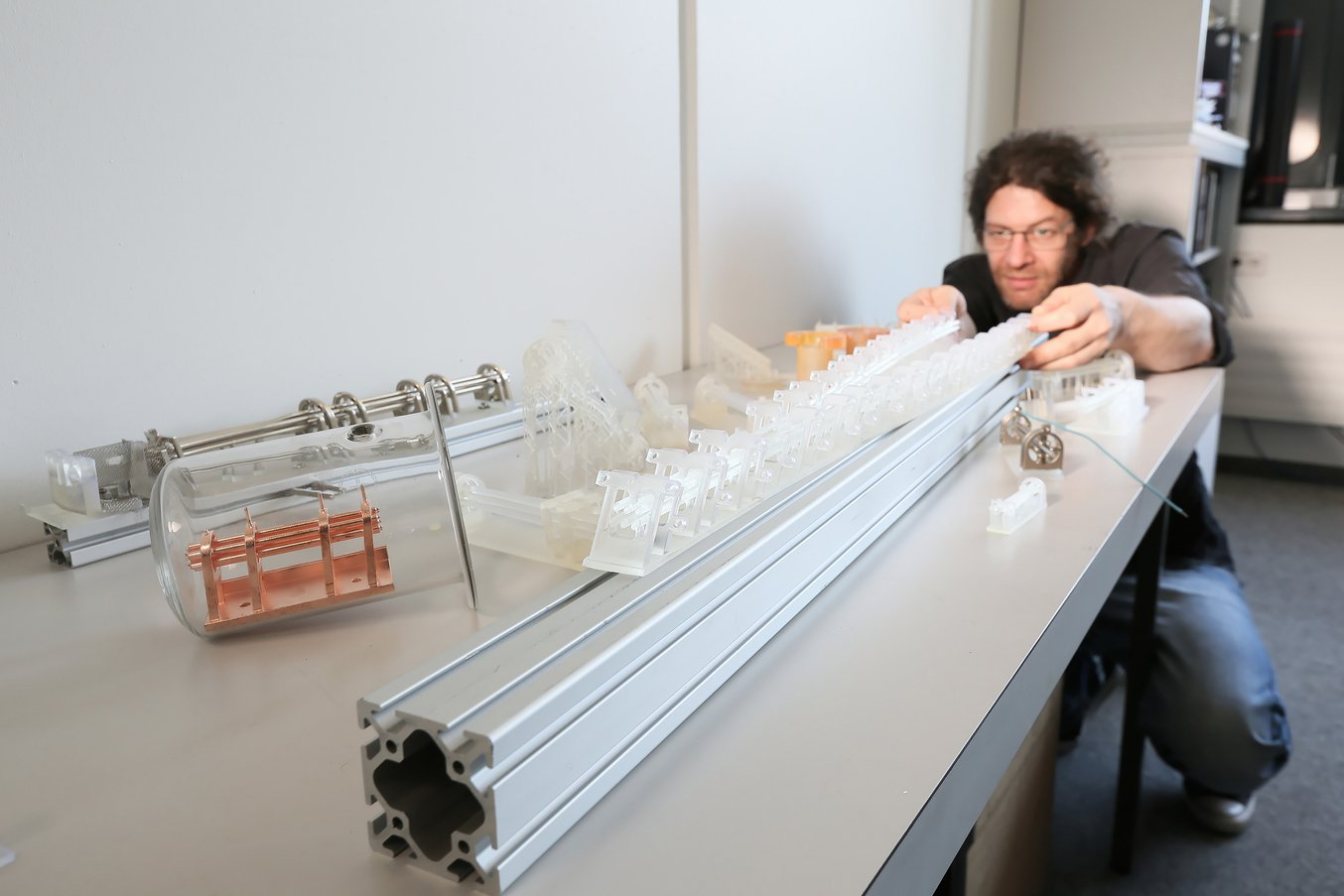 """Osterwalder's office, including his """"museum"""" of 3D printed, partially electroplated parts and his beam splitter."""